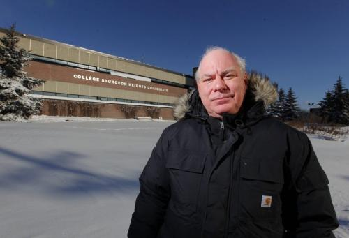 Photo of Bill Jurens in front of the old Sturgeon Creek Highschool on Ness. January 15, 2013  BORIS MINKEVICH / WINNIPEG FREE PRESS