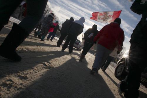 Aprx 25-30 Idle No More protestors headed up Memorial Blvd towards the Manitoba Legislature Wednesday morning near 11 AM-See web brief- January 16, 2013   (JOE BRYKSA / WINNIPEG FREE PRESS)