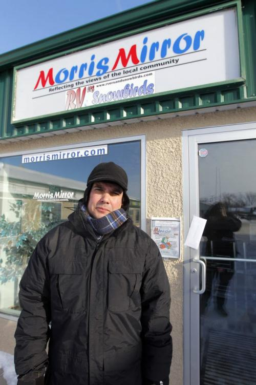 "MORRIS, MB - Niigaanwewidam James Sinclair poses in Morris at the Morris Mirror newspaper. There he delivered a letter to the editor (he taped it to the front door) The Mirror ripped native people calling them ""lazy"" and ""terrorists"" in the paper. January 22, 2013  BORIS MINKEVICH / WINNIPEG FREE PRESS"