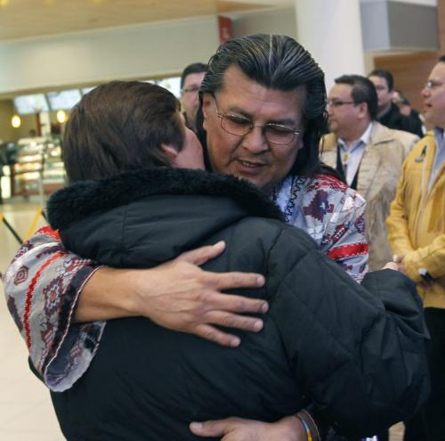 Raymond Robinson embraces his wife after he arrivied at James A. Richardson International Airport, Robinson ended a six week fast with Attawapiskat Chief Theresa Spence. Alex Paul story  (WAYNE GLOWACKI/WINNIPEG FREE PRESS) Winnipeg Free Press  Jan. 25 2013