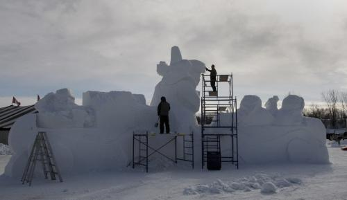 Final Preparations being done on snow scupture entrance   by right Dave Maddocks  and left Barry  Bonhan   titled Fiddle Me Home  , at the entrance  to the park - Festival du Voyageur starts Friday Feb 15 with a Torchlight Walk and opening ceremony  and daily events  running till Feb 24 , final preparations are being made  KEN GIGLIOTTI / FEB 14 2013 / WINNIPEG FREE PRESS