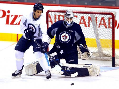 Patrice Cormier tries to deflect a shot past goalie Edward Pasquale during practice at the MTS Centre in Winnipeg Wednesday afternoon.. March 20, 2013  BORIS MINKEVICH / WINNIPEG FREE PRESS