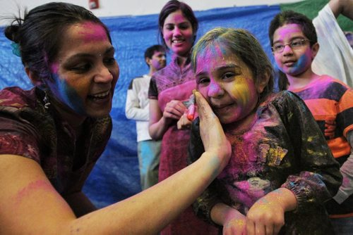 Shweta Banthia and her daughter Van, 4, observe Holi, a religious spring festival celebrated by Hindus as a festival of colours at the Dr. Raj Pandey Hindu Centre Sunday afternoon.  130330 March 30, 2013 Mike Deal / Winnipeg Free Press