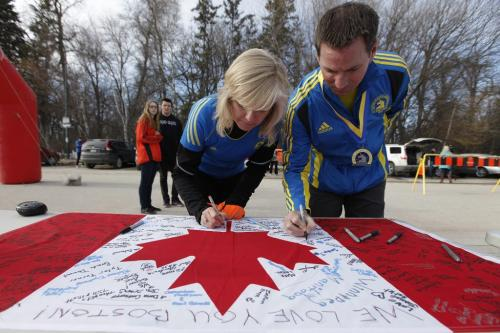 April 16, 2013 - 130416  -  Ramona and Tim Turner joined about 300 people at the Assiniboine Park duckpond for a 5km run and signing of a canadian flag in support of the Boston MArathon victims Tuesday, April 16, 2013. Tim ran the Boston Marathon yesterday. John Woods / Winnipeg Free Press