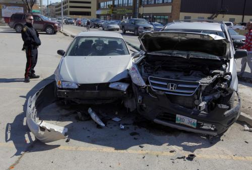 MVC in front of the Part Source on Notre Dame and Balmoral. April 19, 2013  BORIS MINKEVICH / WINNIPEG FREE PRESS