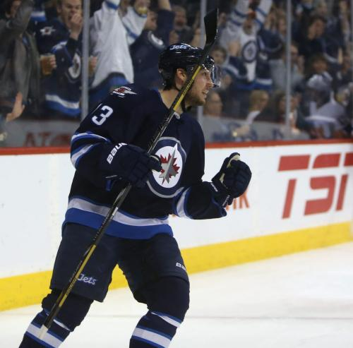 Winnipeg Jets' Kyle Wellwood (13) celebrates his second goal of the second period period NHL action against the New York Islanders' at MTS Centre in Winnipeg, Saturday, April 20, 2013. (TREVOR HAGAN/WINNIPEG FREE PRESS)