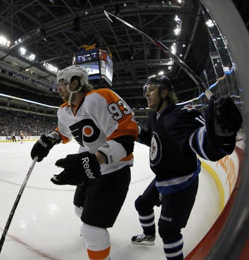 Philadelphia Flyers Jakub Voracek (93) battles with Winnipeg Jets' Bryan Little (18) during the first period of NHL action at MTS Centre in Winnipeg, Saturday, April 6, 2013. (TREVOR HAGAN/WINNIPEG FREE PRESS)