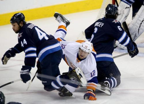 Winnipeg Jets' Zach Bogosian (44) and Ron Hainsey (6) combine on a hit against New York Islanders' Josh Bailey (12) to the right of goaltender Ondrej Pavelec (31) during first period NHL action at MTS Centre in Winnipeg, Saturday, April 20, 2013. (TREVOR HAGAN/WINNIPEG FREE PRESS)