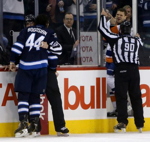 Winnipeg Jets' Zach Bogosian (44) and New York Islanders' Kyle Okposo (21) yell at each other during second period NHL action at MTS Centre in Winnipeg, Saturday, April 20, 2013. (TREVOR HAGAN/WINNIPEG FREE PRESS)