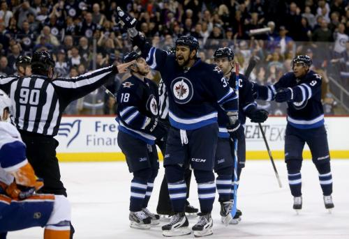 Winnipeg Jets' Dustin Byfuglien (33) reacts to a disallowed goal after time expired at the end of the second period of NHL action against the New York Islanders' at MTS Centre in Winnipeg, Saturday, April 20, 2013. (TREVOR HAGAN/WINNIPEG FREE PRESS)