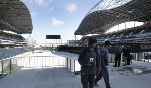 Winnipeg Blue Bombers players (left) Johnny Sears and Terrence Edwards check out the new Investors Group Field Monday morning . Wayne Glowacki/Winnipeg Free Press April 22 2013