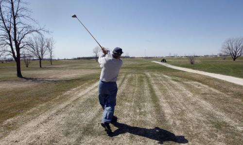 Golfer Frank Sclamacis tees off on a round of golf- City of Winnipeg is putting the John Blumberg Park  ,golf , softball and  soccer complex   up for sale -  KEN GIGLIOTTI / May 13  2013 / WINNIPEG FREE PRESS