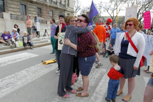 Bill 18. International day against Homophobia at the leg.  Evan Wiens gets a hug from Nancy Allan. May 16, 2013  BORIS MINKEVICH / WINNIPEG FREE PRESS