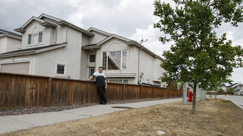 Island Lakes resident Richard Hywaky outside his home on Friday, June 7, 2013. He refuses to mow the city boulevard bordering his property and says it's an infringement of his rights to force him to do so. (ALDO SANTIN) (JESSICA BURTNICK/WINNIPEG FREE PRESS)