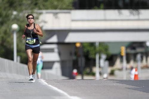 A runner pushes on towards the Mile 18 marker during the Manitoba Marathon in Winnipeg on Sunday, June 16, 2013. (JESSICA BURTNICK/WINNIPEG FREE PRESS)