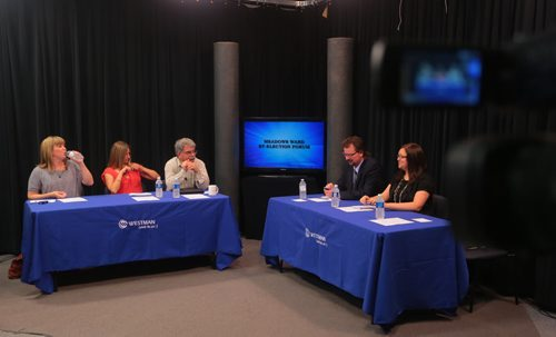 Brandon Sun Candidates for the Meadows Ward by-election, Ramona Coey, Vanessa Hamilton, and John LoRegio, get set for Tuesday night's television debate at Westman Communication Group with Brandon Sun panel members James O'Conner and Jillian Austin. (Bruce Bumstead/Brandon Sun)