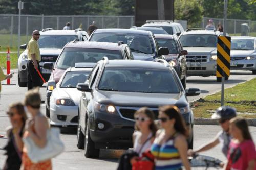 Traffic leading into the Taylor Swift concert working like a well-oiled machine at Investors Group Field on Saturday, June 22, 2013, as it is being directed by event staff and police. (OLIVER SACHGAU) (JESSICA BURTNICK/WINNIPEG FREE PRESS)