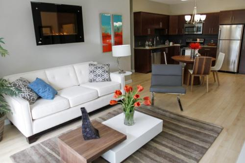 (Living room and adjoining kitchen/dining area in in two-bedroom unit) The Enclave at 2000 St. Mary's Rd. will feature one and two bedroom residences for individuals who are 50 years of age or older. Units emphasize space and luxury, and is the first development to receive Manitoba Hydro's new Power Smart designation for environmental design. Tuesday, June 25, 2013. (TODD LEWYS) (JESSICA BURTNICK/WINNIPEG FREE PRESS)