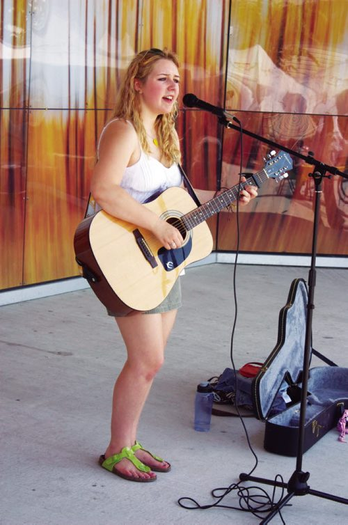 Canstar Community News Windsor Park resident Mikayla Zacharias performs a tune during the Transcona BIZ Market Garden opening at the Transcona Centennial Square on July 4. (DAN FALLOON/CANSTAR COMMUNITY NEWS)
