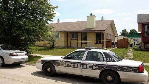 The home on Bondar Bay where Winnipeg Police Service say a 19 year-old male was found unresponsive after a fight at another home in the neighbourhood. The male victim was pronounced dead after being transported from the house.  130721 July 21, 2013 Mike Deal / Winnipeg Free Press