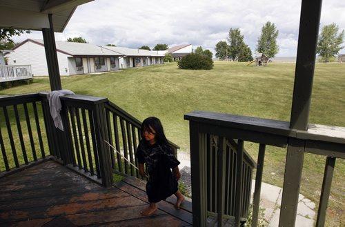 kids love to roam the spacious grounds at the lodge -  Damien  O'Meera  age 3 in poc walkig to his parents cottage -- Misty Lake Lodge is home to any aboriginal flood evacuee from the Lake Manitoba Flood , the  lodge  has not been paid for accommodating evacuees – Randy Turner story-  KEN GIGLIOTTI / JULY 22 2013 / WINNIPEG FREE PRESS