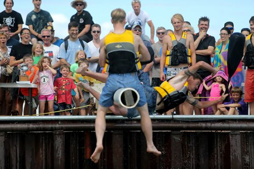 Spectators look on as competitors battle one another with a sponge filled sack, while sitting on a soap covered beam over Gimli Harbour during the Islendingadunk competition at the Icelandic Festival of Manitoba in Gimli, Saturday, August 3, 2013. (TREVOR HAGAN/WINNIPEG FREE PRESS)