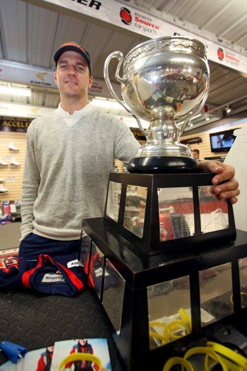Brandon Sun 09082013 AHL player Brett Skinner displays the American Hockey League championship trophy the Calder Cup that he won with his team the Grand Rapids Griffins while making an appearance at Brandon source for Sports on Friday so hockey fans can get a look at the trophy. (Tim Smith/Brandon Sun)