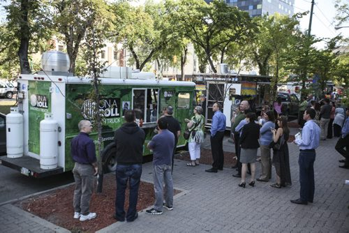 The Downtown BIZ launched the third annual ManyFest beneath the elms on Broadway today with a food truck war between businesses Pimp My Rice, Habanero Sombrero and On A Roll. Wednesday, August 14, 2013. (ELIZABETH FRASER) (JESSICA BURTNICK/WINNIPEG FREE PRESS)