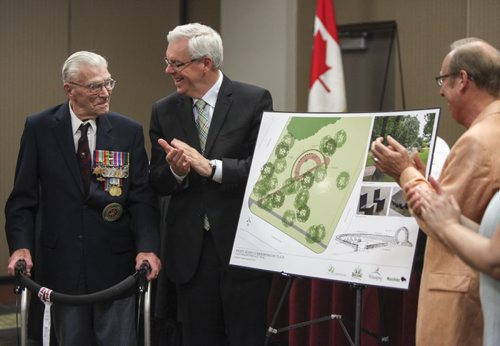 (Left to right) George Peterson, the sole surviving member of the Arden Seven, Premier Greg Selinger and Mayor Sam Katz applaud following the unveiling of plans for a new park plaza in honour of seven comrades who grew up on Arden Ave. in Winnipeg. They volunteered, fought and were captured during the Battle of Hong Kong during the Second World War in 1941. The Arden Seven Interpretive Plaza, to be located in Jules Mager Park in St. Vital, commemorates comrades Fred Abrahams, twins Morris and George Peterson, and brothers Alfred, Edward and Harry Shayler, all of whom survived the battle of Hong Kong. Friday, August 16, 2013.  (OLIVER SACHGAU) (JESSICA BURTNICK/WINNIPEG FREE PRESS)