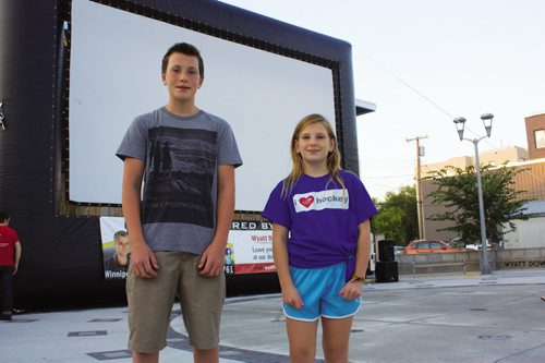 Canstar Community News Aug. 15, 2013 - Transcona residents Ben and Jolene Galagan are shown in front of the big screen prepared to show Beethoven's Christmas Adventure at Transcona Centennial Square on Aug. 15. The siblings were extras in the film. (DAN FALLOON/CANSTAR COMMUNITY NEWS/HERALD)
