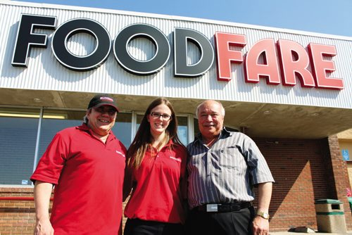 Canstar Community News From left: Darcy Drall, meat counter manager; Heather Reid, store manager; and Moe Zeid, store owner.