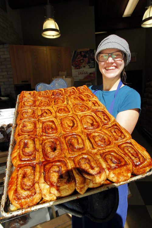 This is for a story celebrating National Cinnamon Bun Day. Reba Terlson of Tall Grass Prairie with some cinnamon buns. BORIS MINKEVICH / WINNIPEG FREE PRESS. Sept. 13, 2013
