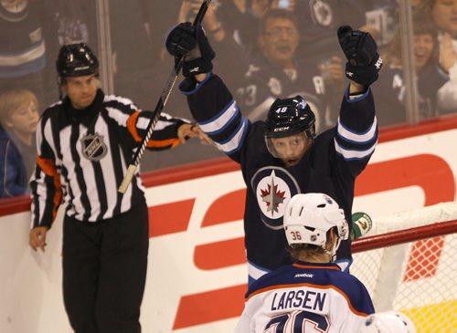 Winnipeg Jets Carl Klingberg celebrates second period goal as Edmonton Oilers Phillip Larsen looks on during NHL pre-season action at the MTS Centre in Winnipeg Tuesday night -See Jets' stories- Sept 17, 2013   (JOE BRYKSA / WINNIPEG FREE PRESS)