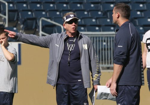 Winnipeg Blue Bombers head coach Tim Burke, left, has a discussion with defensive coordinator Casey Creehan at practice at Investors Group Field in Winnipeg-See Paul Wiecek story- Sept 18, 2013   (JOE BRYKSA / WINNIPEG FREE PRESS)