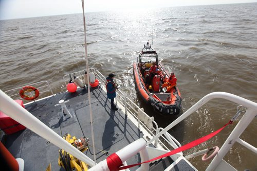 SAREX Marine Rescue Search and Rescue personal team up with the Canadian Coast Guard and Canadian Forces in Gimli Wednesday to perform a mock rescue of a fishing vessel with a trauma victim (with eyeball out of socket) on board their  vessel.  The SARTech responders had to parachute from a hercules airplane into Lake Winnipeg near the stranded boat and climb aboard their vessel to accomplish their mission.  After applying first aid they manage to bring casualty back to Gimli harbour.  Mission accomplished.    See Ashley Priest story. Sept  18,, 2013 Ruth Bonneville Winnipeg Free Press
