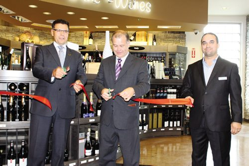 Canstar Community News From left: Al Roney, executive general manager, retail stores, Manitoba Liquor & Lotteries; Jim Rondeau, minister responsible for The Liquor Control Act; and Jason Boyda, store manager cut the ribbon to officially open Winnipeg's newest Liquor Mart, located in Fort Richmond at the corner of Pembina Highway and Kirkbridge Drive.