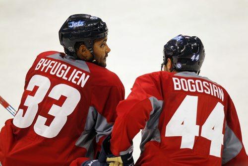 Winnipeg Jets practice at MTS Centre. Dustin Byfuglien and Zach Bogosain. BORIS MINKEVICH / WINNIPEG FREE PRESS. Sept. 20, 2013