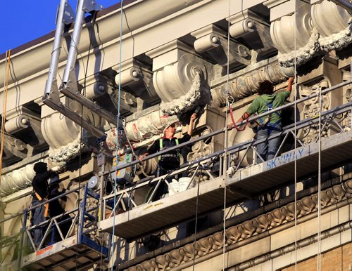 Restoration continues high above the street on the cornice at the top of The Paterson GlobalFoods Institute formerly known the Union Bank Building Tuesday morning on Main St. and William Ave. Built in 1904, it is believed to be Canada's oldest surviving steel and concrete-reinforced skyscraper. Wayne Glowacki / Winnipeg Free Press Sept. 24 2013