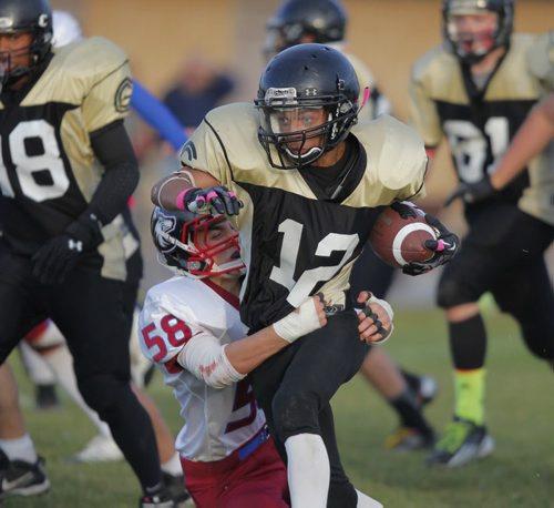 Winnipeg High school Football League. Senior teams. Sturgeon Heights Huskies vs. Garden City Fighting Gophers. Gophers #12 Devon Taylor gets grabbed by Huskies #58 Elliott Ormonde. BORIS MINKEVICH / WINNIPEG FREE PRESS. Oct. 3, 2013