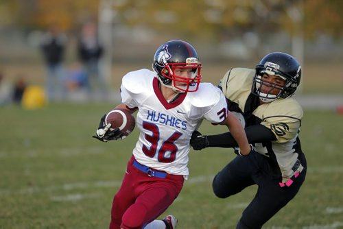 Winnipeg High school Football League. Senior teams. Sturgeon Heights Huskies vs. Garden City Fighting Gophers. Huskies #36 Stephen Hart evades Gophers #34 Marcus Brown. BORIS MINKEVICH / WINNIPEG FREE PRESS. Oct. 3, 2013