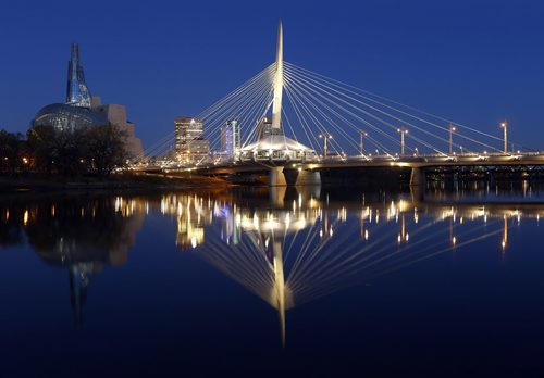 stdup – Esplanade Riel reflecting on the Red River  before dawn with the Canadian Museum for Human Rights in the background  KEN GIGLIOTTI / Oct. 18 2013 / WINNIPEG FREE PRESS CMHR