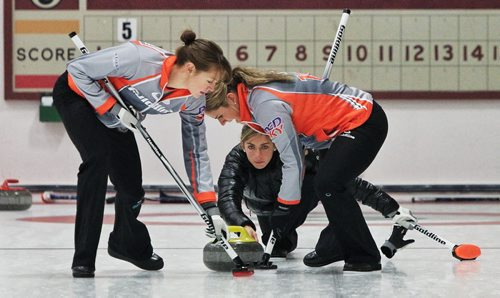 Skip Eve Muirhead (centre) throws a rock during a draw with Team Sweeting in the 2013 Women's Curling Classic at the Fort Rouge Curling Club Sunday morning. 131027 - October 27, 2013 MIKE DEAL / WINNIPEG FREE PRESS