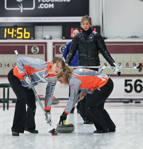 Claire Hamilton (left) looks down the rink after Skip Eve Muirhead threw a rock during a draw with Team Sweeting in the 2013 Women's Curling Classic at the Fort Rouge Curling Club Sunday morning. 131027 - October 27, 2013 MIKE DEAL / WINNIPEG FREE PRESS