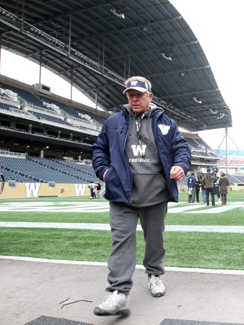 Winnipeg Blue Bombers head coach Tim Burke leaves the field after practice at IGF- The team will play their final game of the 2013 season this Saturday against the Hamilton Tiger-Cats-  See Paul Wiecek story- Oct 31, 2013   (JOE BRYKSA / WINNIPEG FREE PRESS)