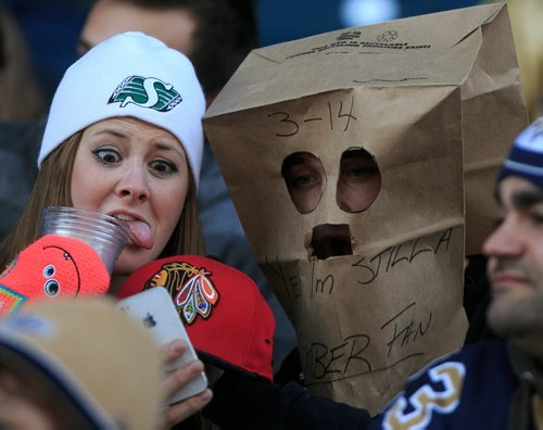 Fans take a photo of their outfits (and a Blackhawks cap) at another Winnipeg Blue Bombers loss at Investors Group Field on Saturday. The Bombers loss the final game of the season against the Hamilton Tiger Cats. 131023 - Wednesday, October 23, 2013 - (Melissa Tait / Winnipeg Free Press)