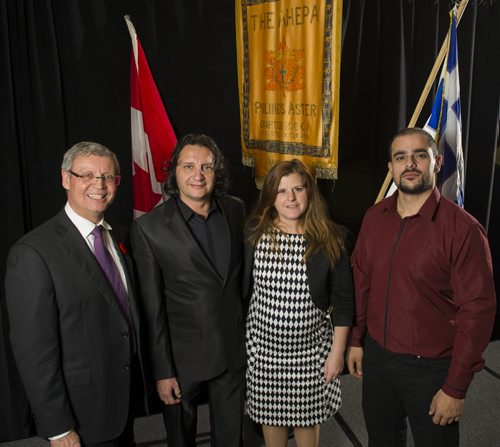 "131102 Winnipeg - DAVID LIPNOWSKI / WINNIPEG FREE PRESS (November 02, 2013) (L-R) Greek Community of Winnipeg president Chris Katopodis, Stefanos Boukis, Lia Andronikou, and Angelos Karatsialis at the ""OXI Day"" Banquet Saturday night.   Carol Sanders story about surge of Greeks fleeing the chaos in their homeland and coming to Winnipeg in the biggest wave of Greek immigrants since the 1980s."