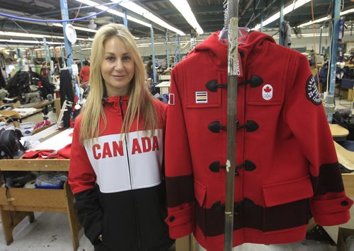 Marissa Freed with Freed & Freed International Ltd. wearing one of the styles of  the Canadian Olympic team's outwear they have made. Gord Sinclair  story Wayne Glowacki / Winnipeg Free Press Nov. 7. 2013