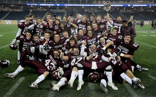 The St.Paul's Crusaders AAA football team celebrates their Anavet Cup victory over the Murdoch McKay Clansmen by a score of 56-8 at Investors Group Field, Friday, November 8, 2013. (TREVOR HAGAN/WINNIPEG FREE PRESS)