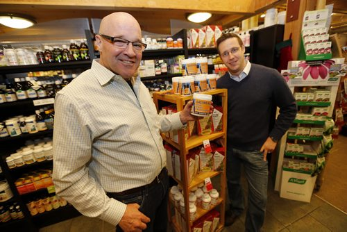 John Hare (left) story about how he has taken his egg technology to create a product called Gastro Aid, a powder that helps build human immunity. It's just been picked up by Vita Health stores. In pic with (right) Mathew Holtmann  President of Vita Health Fresh Market