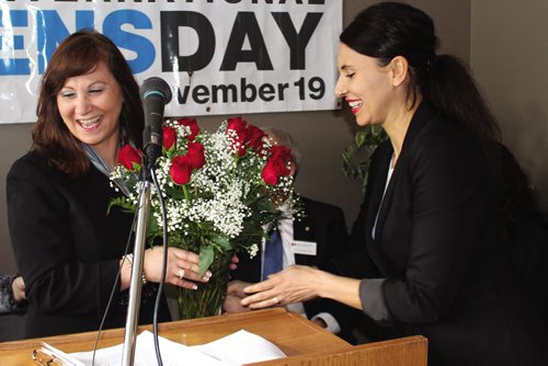 Canstar Community News Just prior to making some closing remarks at the grand opening of the Men's Resource Centre of Manitoba, Suhad Bisharat is presented with a boquet of roses on behalf of her staff. (JORDAN THOMPSON)
